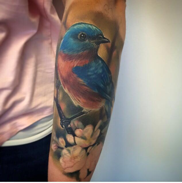 Cute bird tattoo on forearm