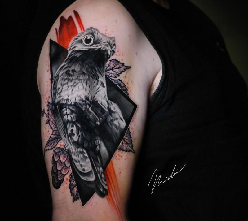 Cute bird tattoo on shoulder
