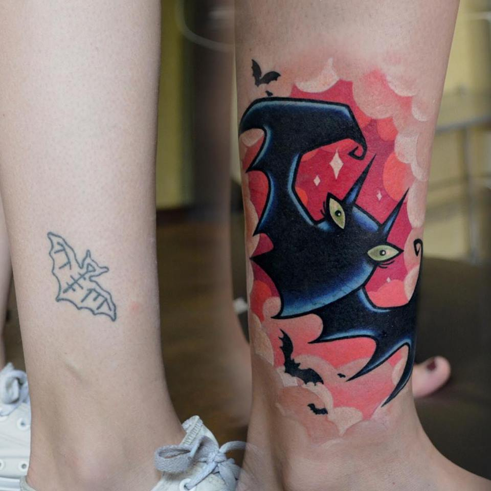 Cute cartoon bat tattoo on leg