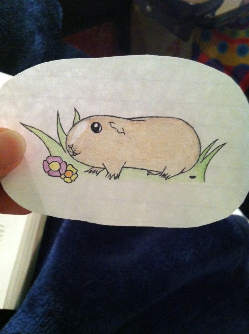 Cute cartoon light-colored rodent sitting in grass tattoo design