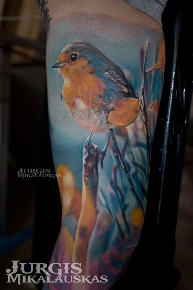Cute colorful bird tattoo on sleeve