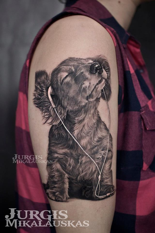 Cute dog with haedphones tattoo on shoulder