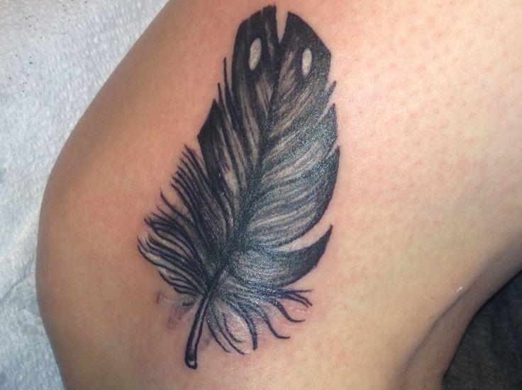 Cute fluffy black feather tattoo