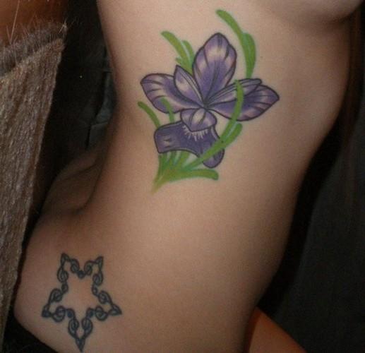 Cute little iris flower tattoo on side