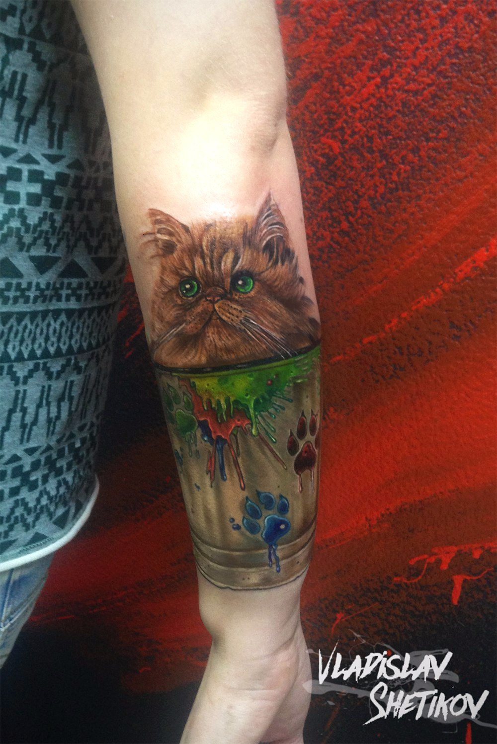 Cute little kitty in glass tattoo