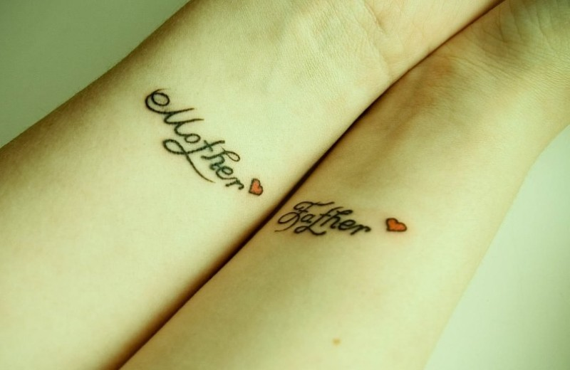 Cute mother and father quotes with red tiny hearts tattoo on arms