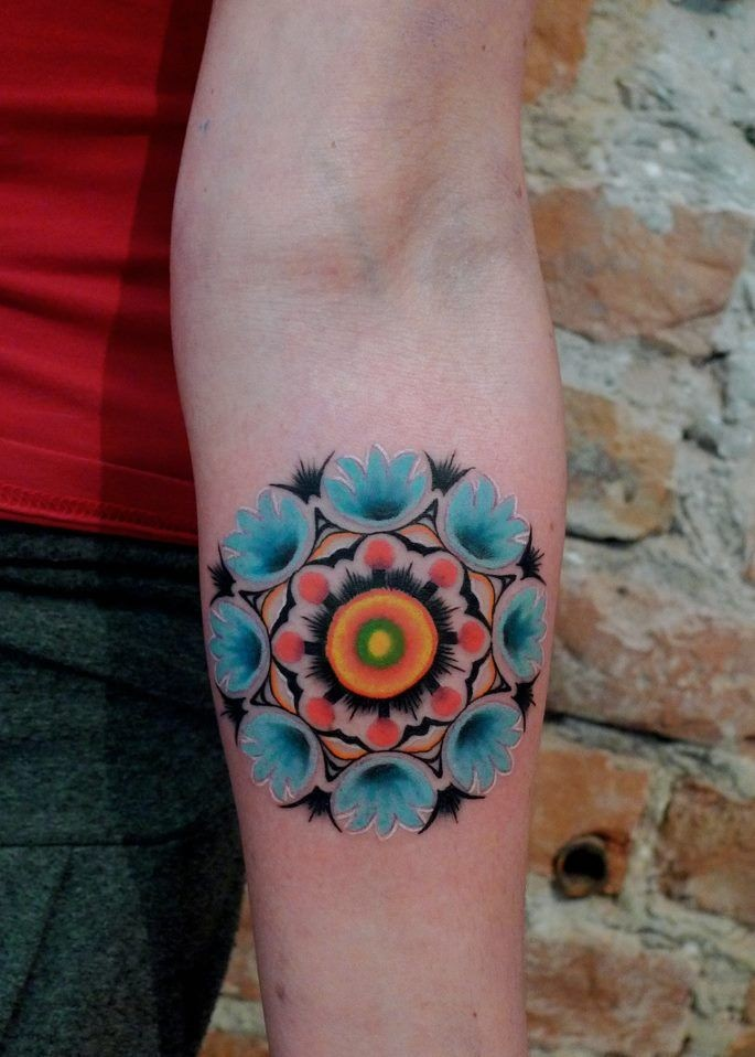 Cute painted by Mariusz Trubisz forearm tattoo of nice flower