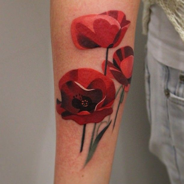 Cute poppy flowers tattoo on arm