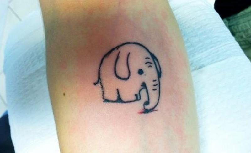 Cute simple black-contour elephant tattoo on forearm