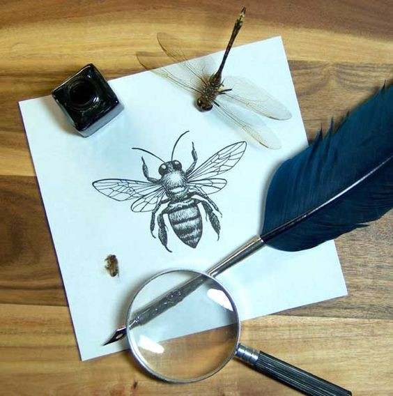 Cute small black-and-white bee tattoo design