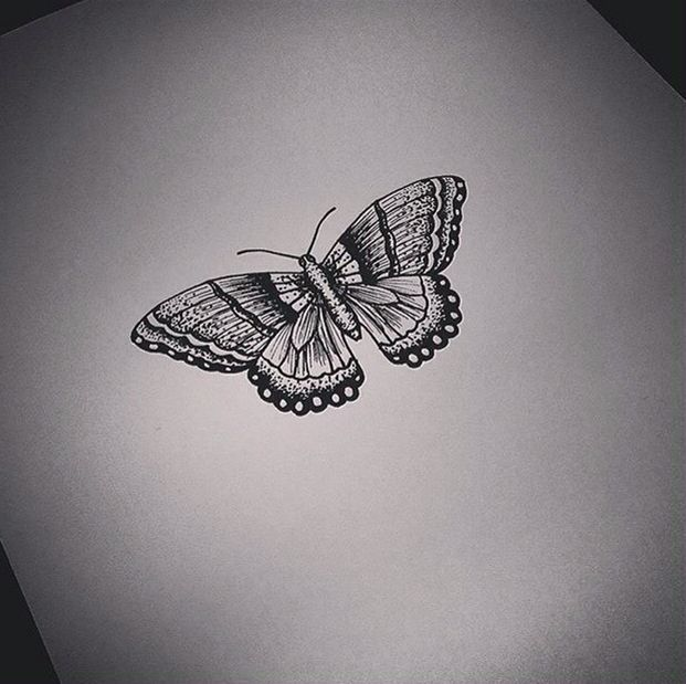 Cute small black-and-white butterfly tattoo design