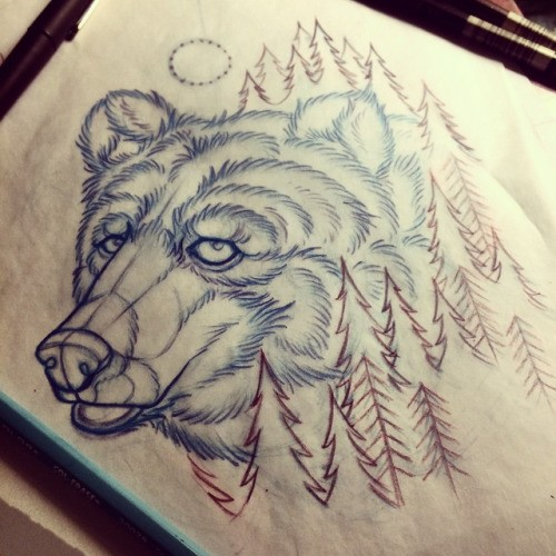 Cute uncolored grizzly head surrounded with small fur-trees tattoo design