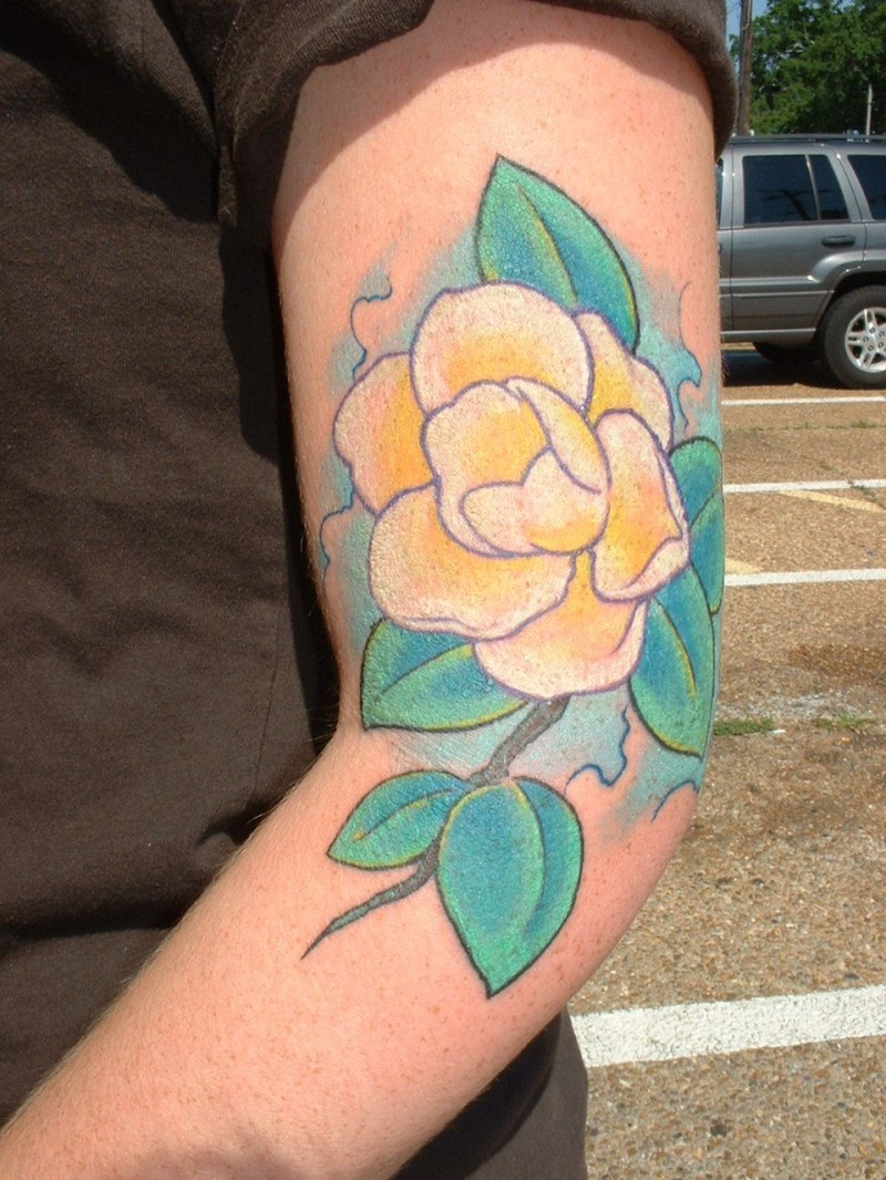 Cute yellow magnolia flower tattoo on arm