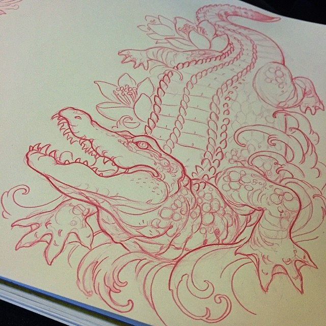 Dangerous red-ink reptile with flowers in water waves tattoo design