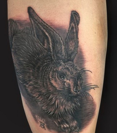 Dark fluffy hare tattoo on shin