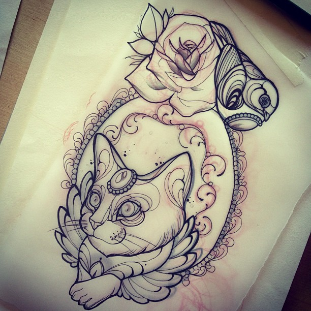 Decorated cat in frame with rose bud and bird tattoo design