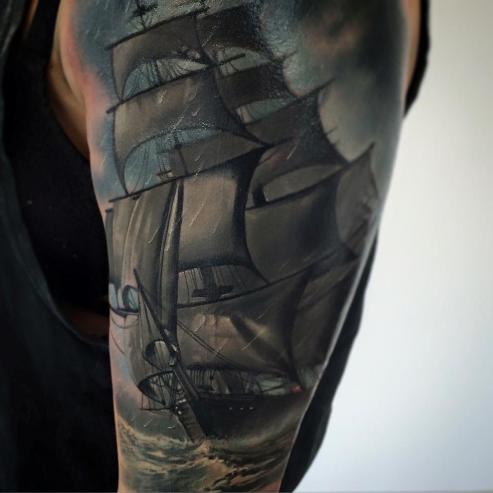 Detailed ship tattoo on shoulder