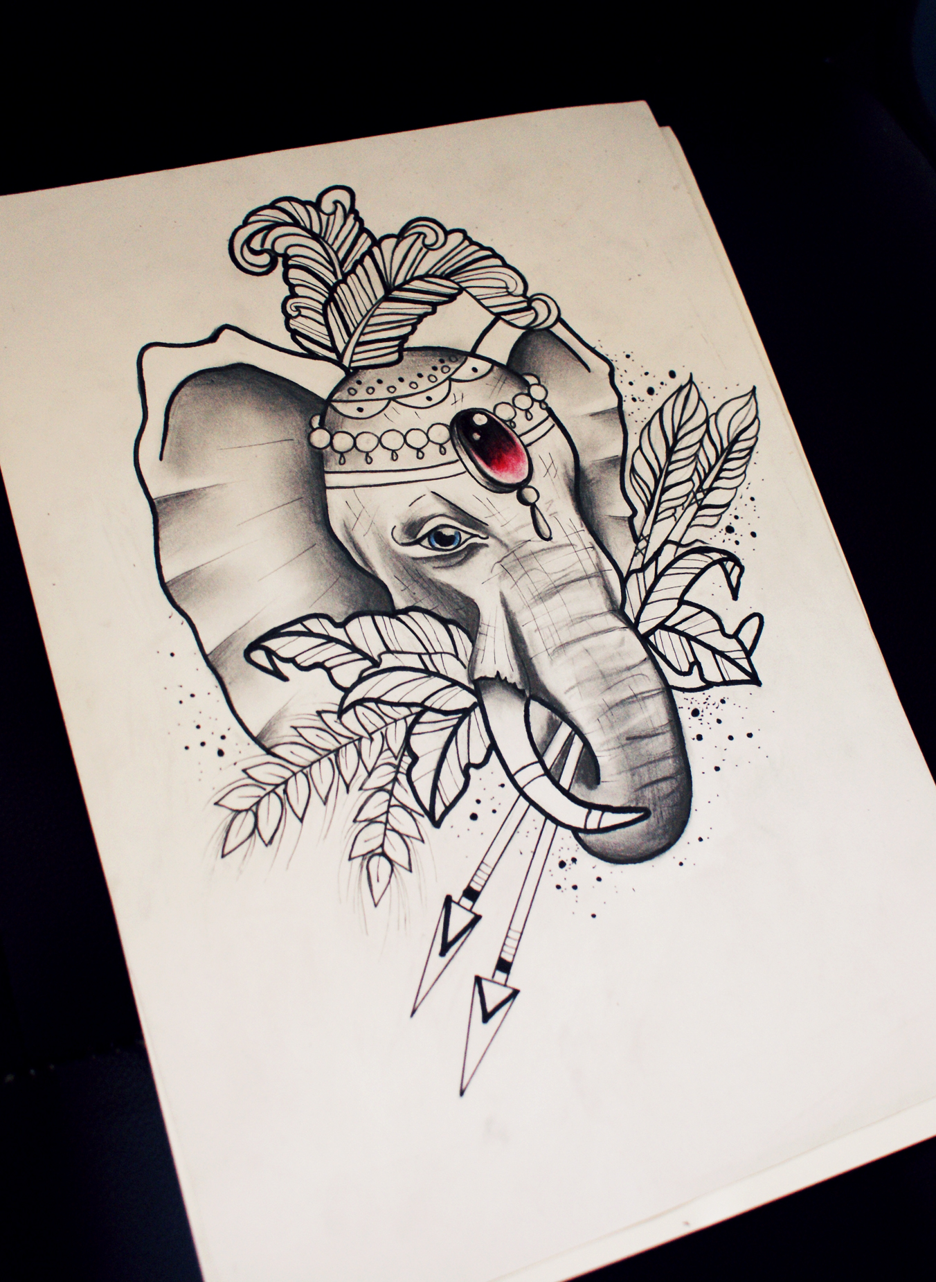 Dlue-eyed circus elephant with red gem decoration keeping arrows tattoo design