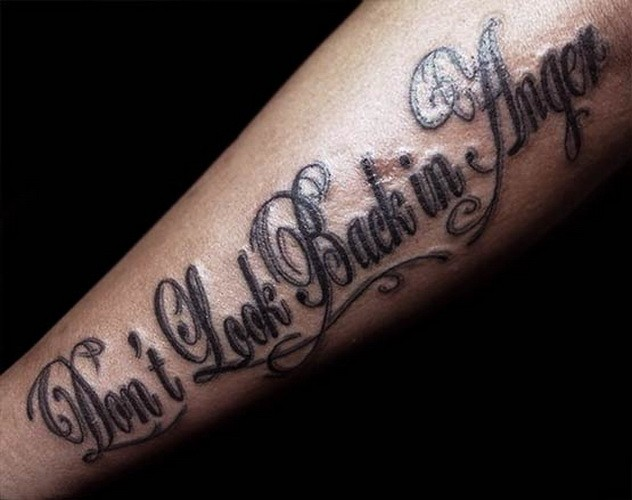 Don't look back in anger quote tattoo on arm