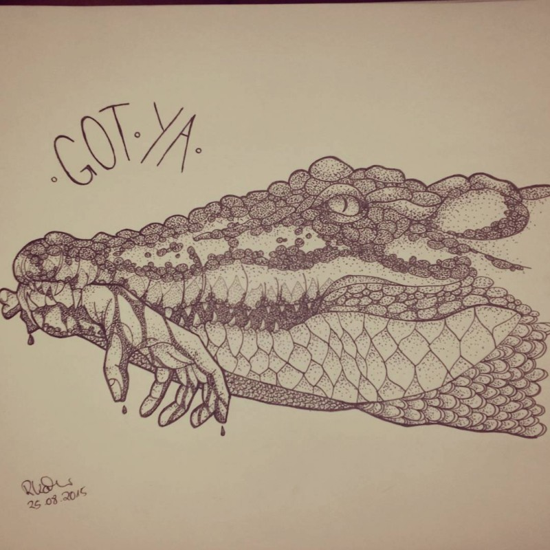 Dotwork-style reptile head with human hand in jaws tattoo design
