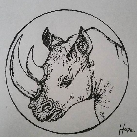 Dotwork-style rhino portrait framed with circle tattoo design