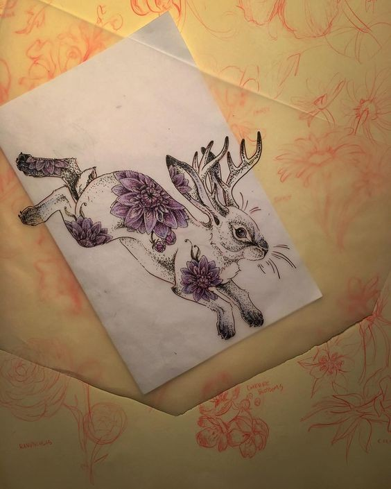 Dotwork elk-horned running rabbit with purple flower print tattoo design
