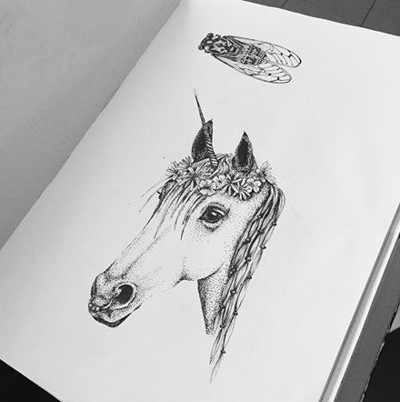 Dotwork unicorn head in floral wreath tattoo design