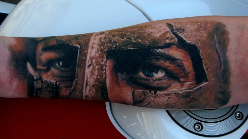 Dramatic Spartan warrior look tattoo on forearm