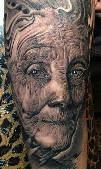 Dramatic accurate painted tattoo of old woman portrait