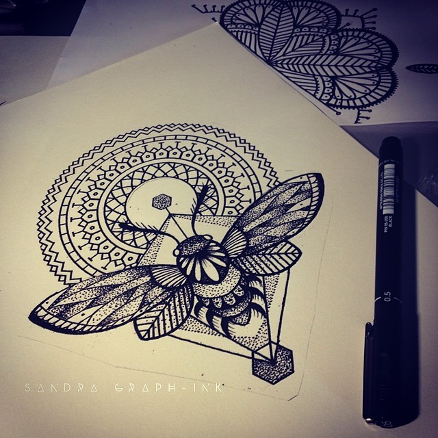 Elegant bee with round mandala and geometric drawings tattoo design