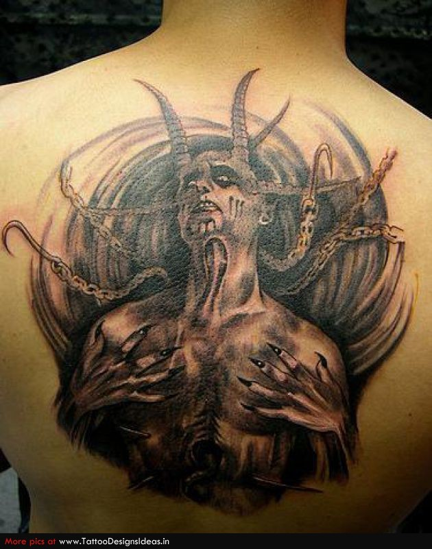 Enormous black ink upper back tattoo of devil monster with chains