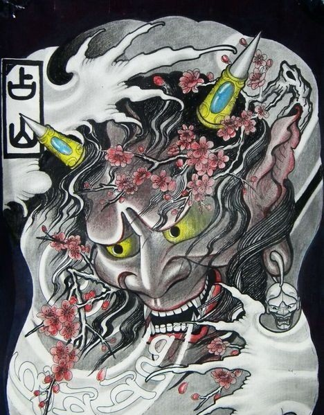 Evil japanese devil with decorated horns and cherry blossom tattoo design