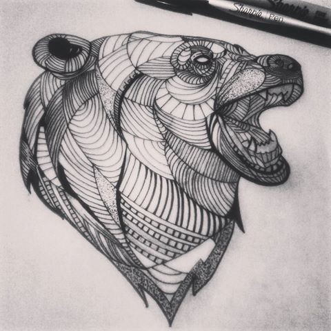 Exiting line-patterned grizzly head in profile tattoo design