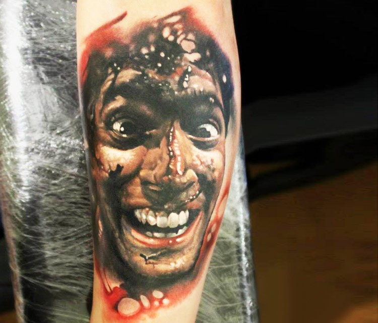 Famous horror movie hero bloody portrait tattoo on arm