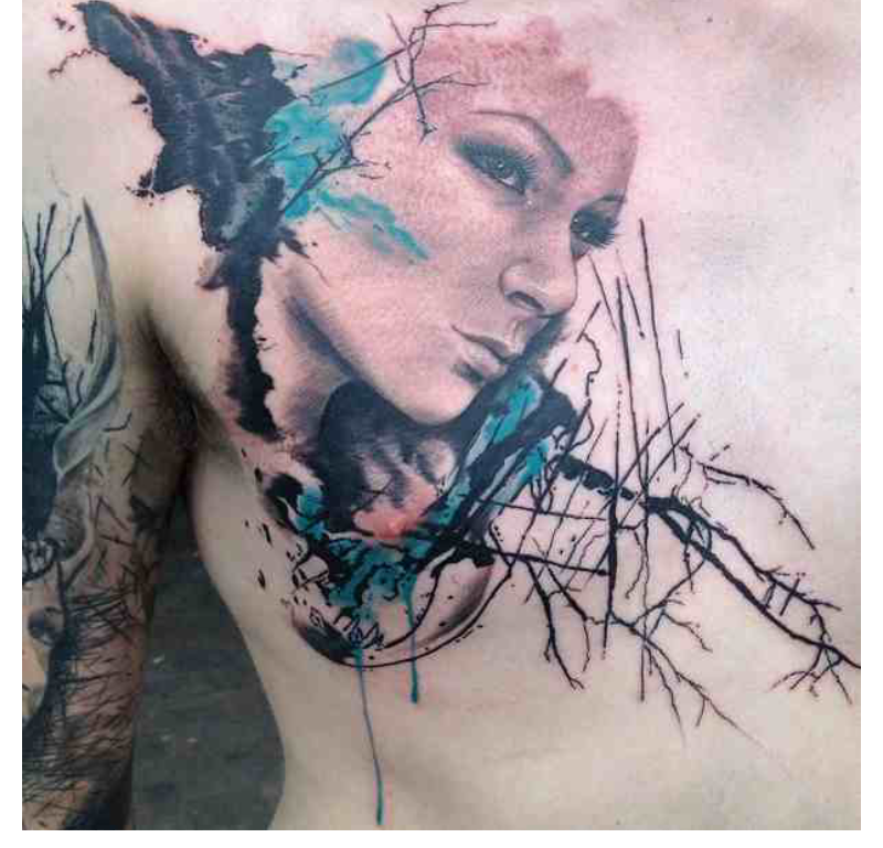 Fantas style colored chest tattoo of woman portait stylized with trees
