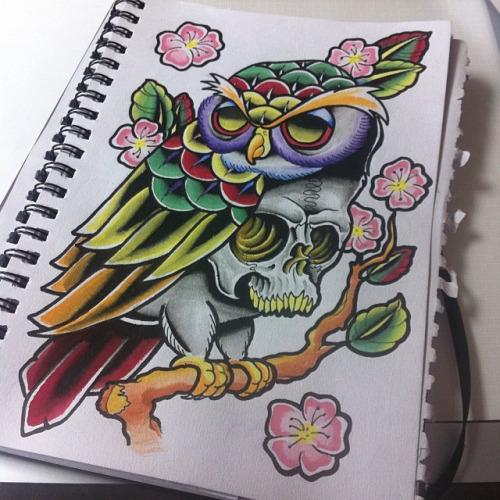 Fantastic multicolor owl and a skull in cherry blossom tattoo design