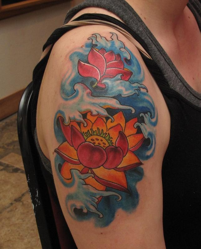 Fantastic Orange Japanese Flowers In Blue Waves Tattoo On Shoulder