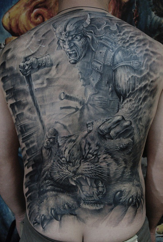 Fierce warrior killing a tiger tattoo on back