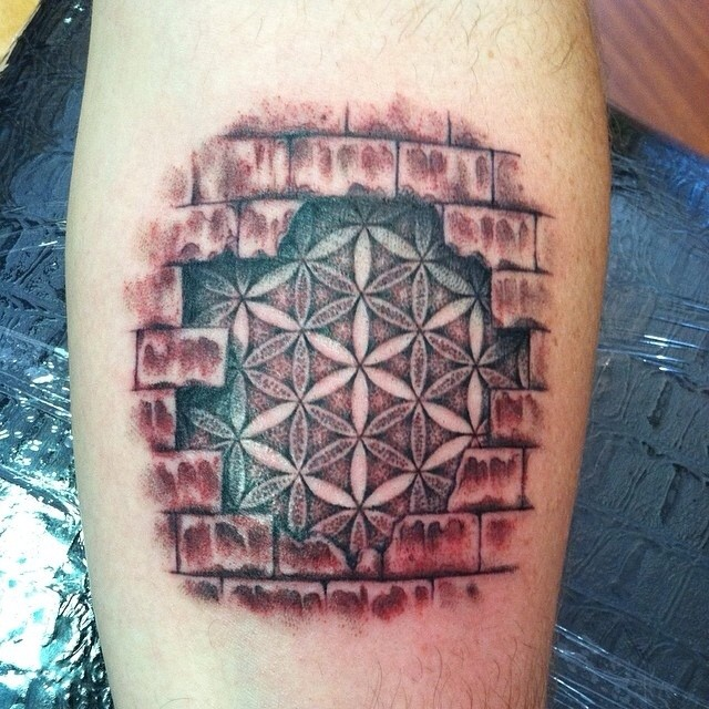 flower of life in brick wall tattoo on arm. Black Bedroom Furniture Sets. Home Design Ideas