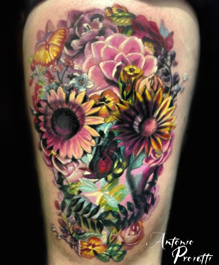 Flower sugar skull tattoo by Antonio Proietti