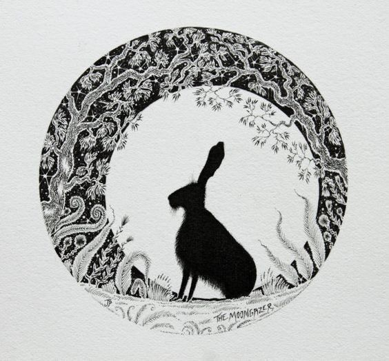 Fluffy black hare sitting in charming tree-printed circle tattoo design