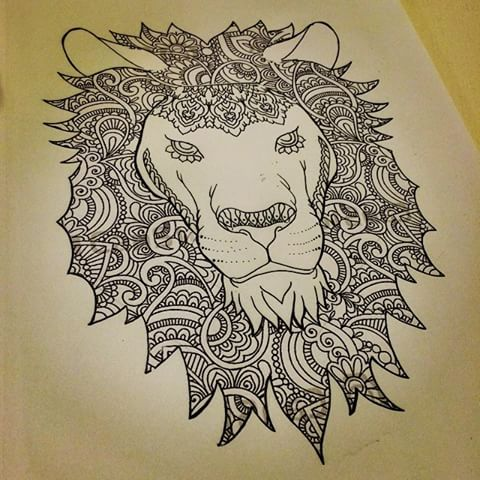Folk-ornamented lion portrait tattoo design