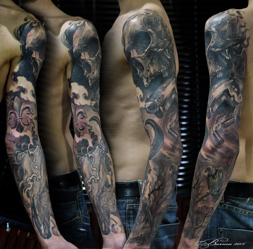 Full sleeve tattoo with skull, fleur de liss, gun, dryed tree