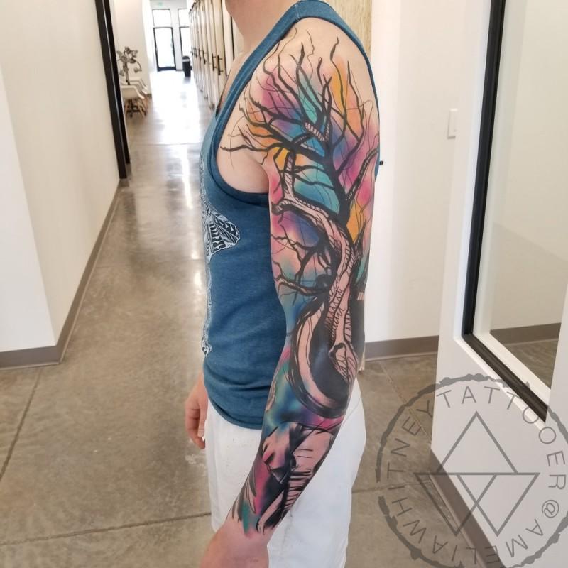Full sleeve watercolor tree tattoo on arm