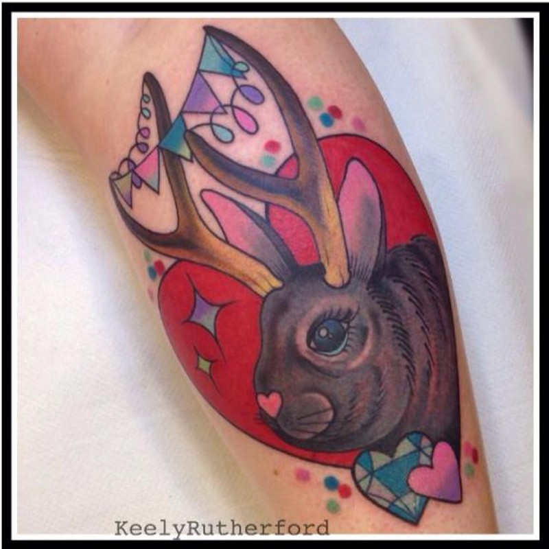 Funny and romantic painted unusual animal bunny with deer horns tattoo on arm
