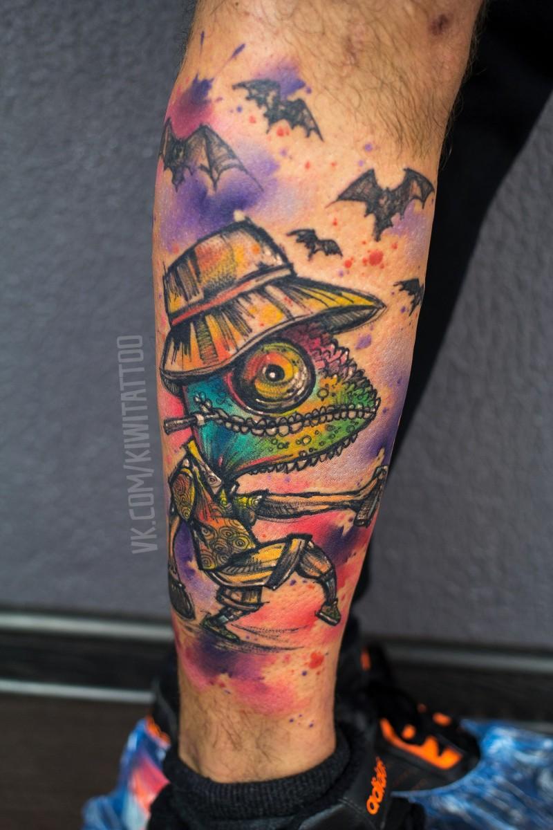 Funny chameleon tattoo on leg