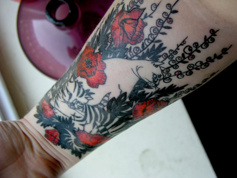 Funny colorful cats in poppy flowers tattoo for guys on forearm