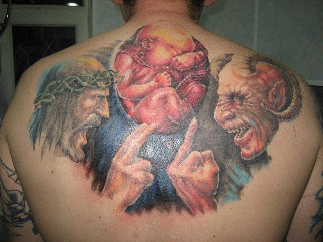 Funny designed colorful upper arm tattoo of devil with God and little child