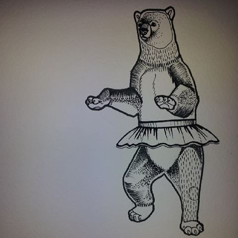 Funny grey-ink dancing grizzly in skirt tattoo design