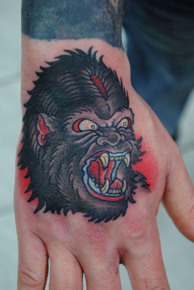 Furious bushy old school gorilla head tattoo on hand